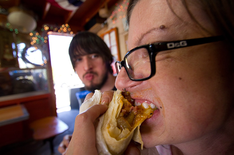 Rainy and Joe enjoying a Pastrami Burrito at Oki Dog in Hollywood, California