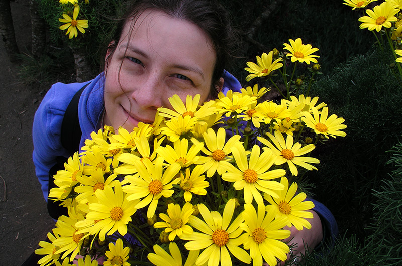 Caroline Wise posing with flowers on Anacapa Island in the Channel Islands during 2004