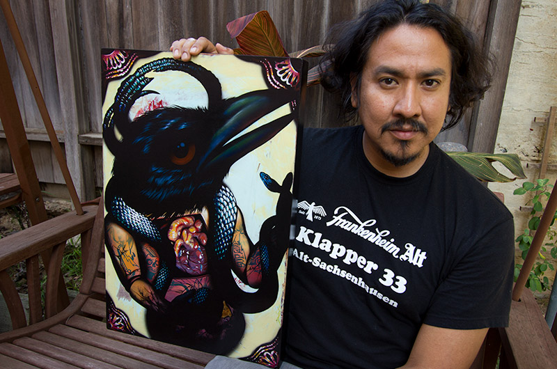 Artist Dion Terry holding his most recent work, Pillow Talking The Devil - photo taken in San Diego, California on October 1, 2010