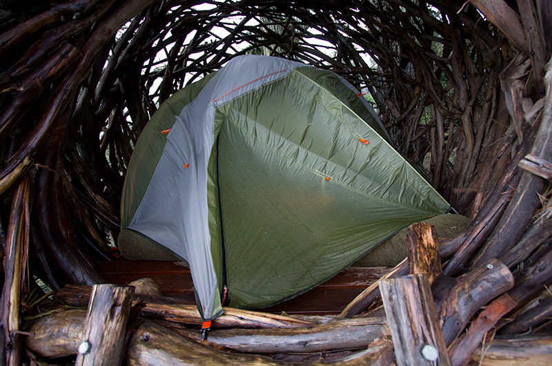 Our tent shrinking from the wind that is pushing it about inside the Nest at Treebones Resort in Big Sur, California