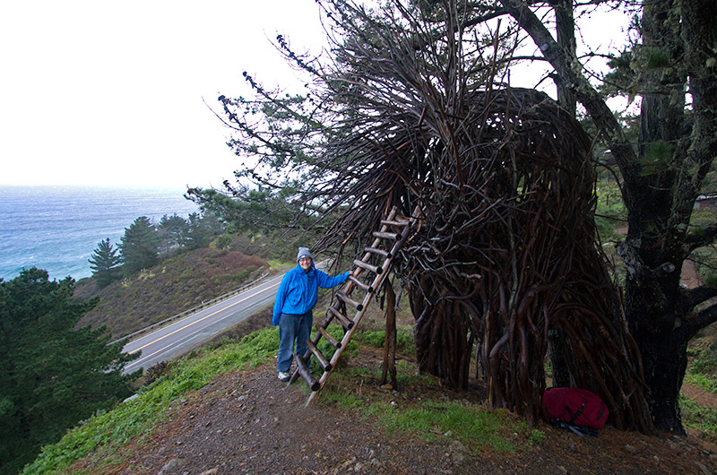 Caroline Wise outside the Nest on a rainy windy day at Treebones Resort in Big Sur, California