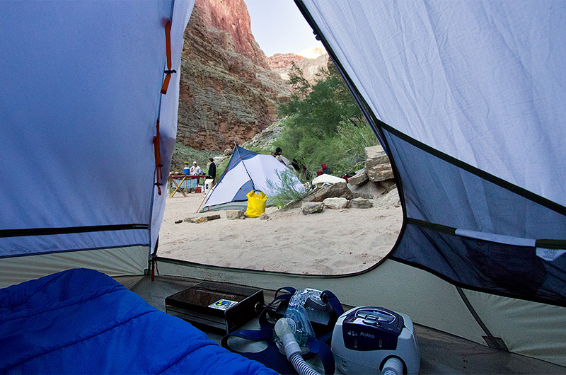 CPAP equipment including battery inside tent at camp site next to the Colorado River in the Grand Canyon