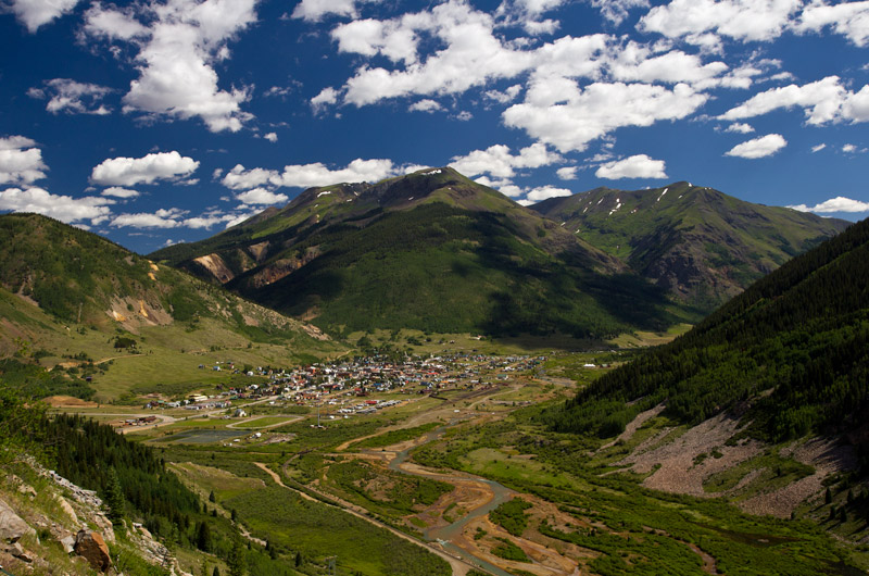 The old mining town of Silverton, Colorado seen from a road high above the valley.