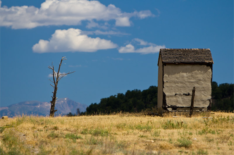 A random shack not much larger than an outhouse sits falling apart on the way to Ignacio, Colorado