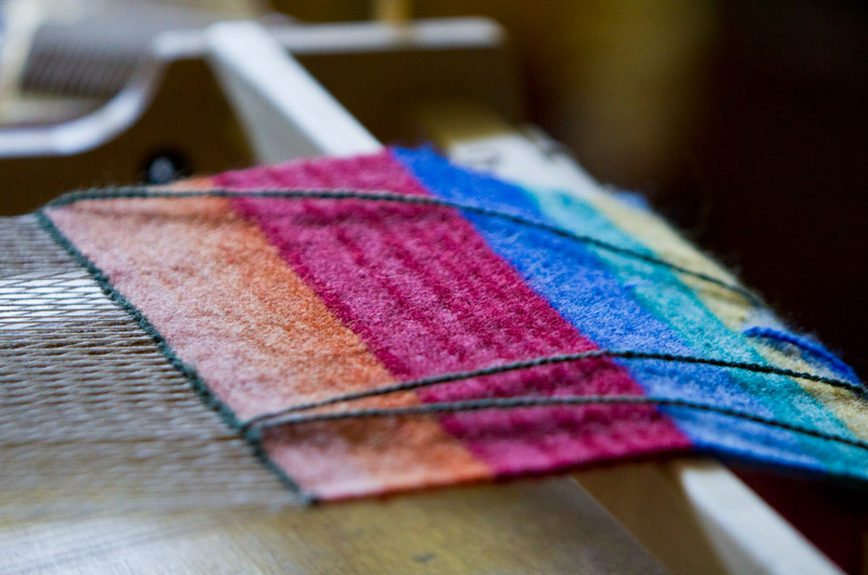Working a new weaving on a Tapestry Loom at IWC in Durango, Colorado