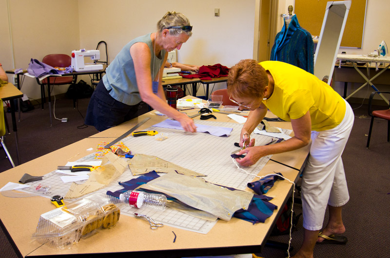 Cutting patterns in the sewing workshop at IWC in Durango, Colorado