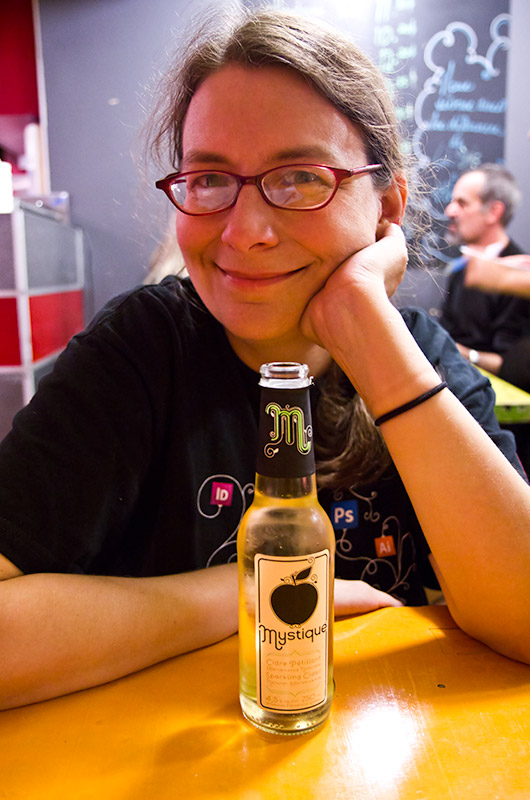 Caroline Wise at La Banquise enjoying a Mystique hard cider before digging into poutine. Montreal, Canada