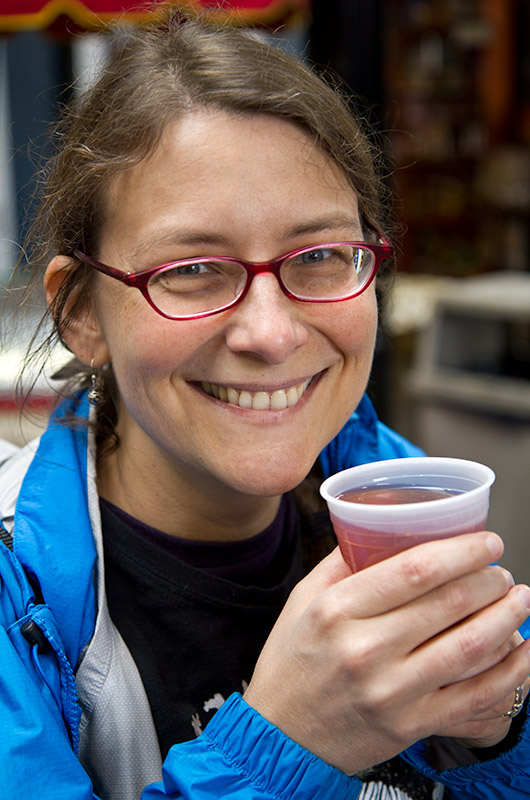 Caroline Wise enjoying cinnamon spiced hot cranberry juice at the Jean-Talon Market in Montreal, Canada