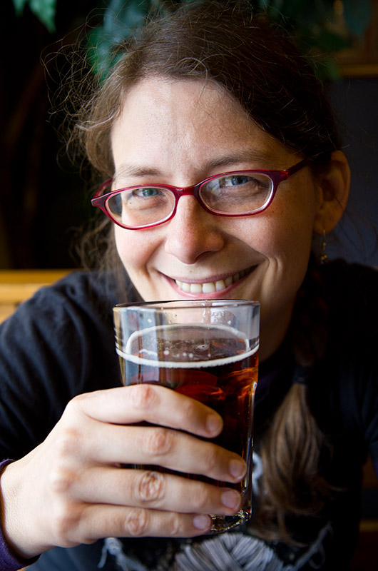 Caroline Wise enjoying a glass of Boreal beer at La Banquise in Montreal, Canada
