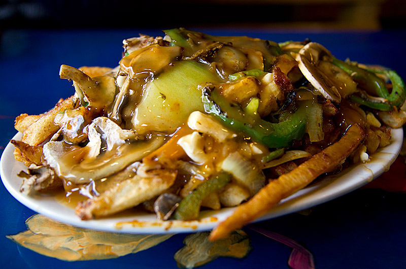 Poutine with mushrooms, onions, green peppers from La Banquise in Montreal, Canada