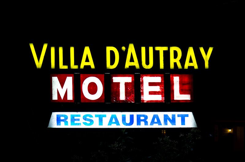 The illuminated sign for Motel Villa D'Autray in Lanoraie, Canada