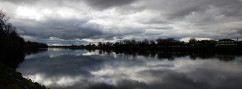 Still waters and reflecting sky in French Canada off the St. Lawrence Seaway