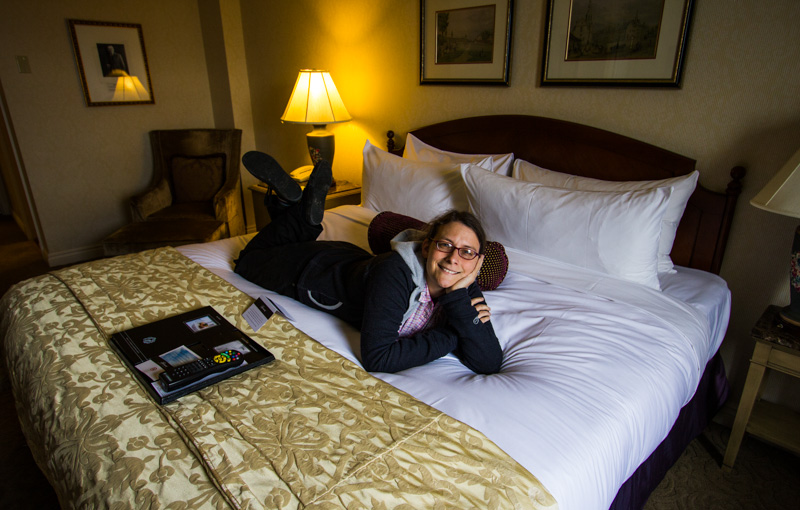 Caroline Wise inspecting our bed at Chateau Frontenac in Quebec City, Canada
