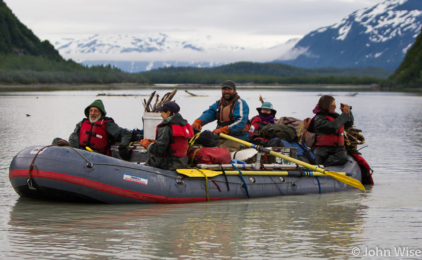 Exiting Door Number 3 is Shaun Cornish and his raft full of travelers. On Alsek Lake in Alaska