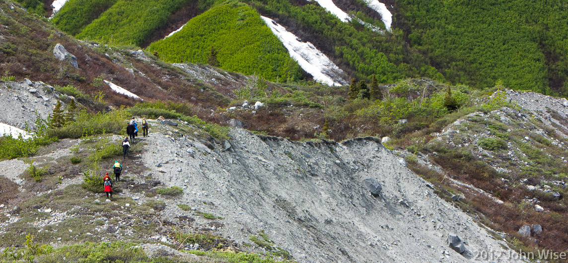 A thin ridge line being hiked for a closer view of the western side of Lowell Glacier in Kluane National Park Yukon, Canada
