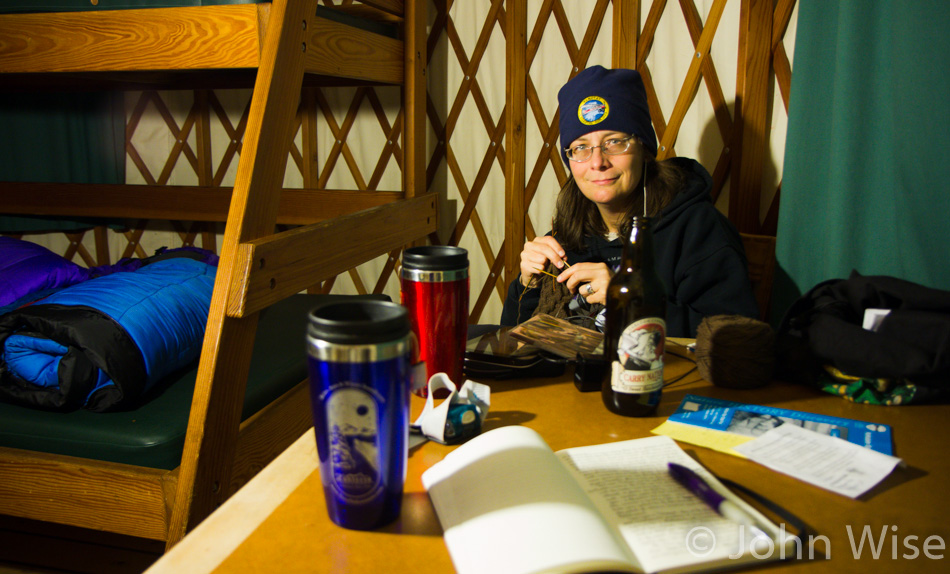 Caroline Wise knitting gloves in a yurt at Nehalem Bay State Park in Oregon