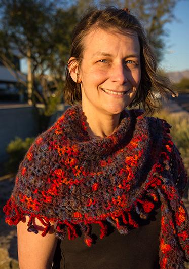 Caroline Wise wearing a knitted shawl she made.