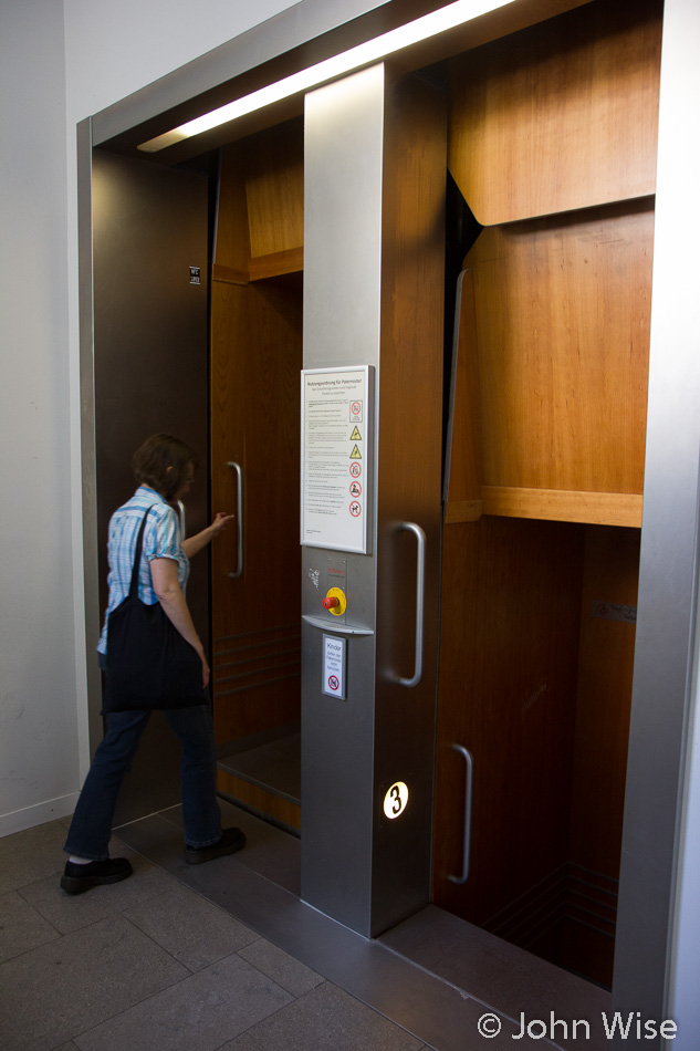 "Caroline Wise entering a ""paternoster"" style elevator at Goethe University in Frankfurt, Germany. Formerly the IG Farben / Abrams Complex"