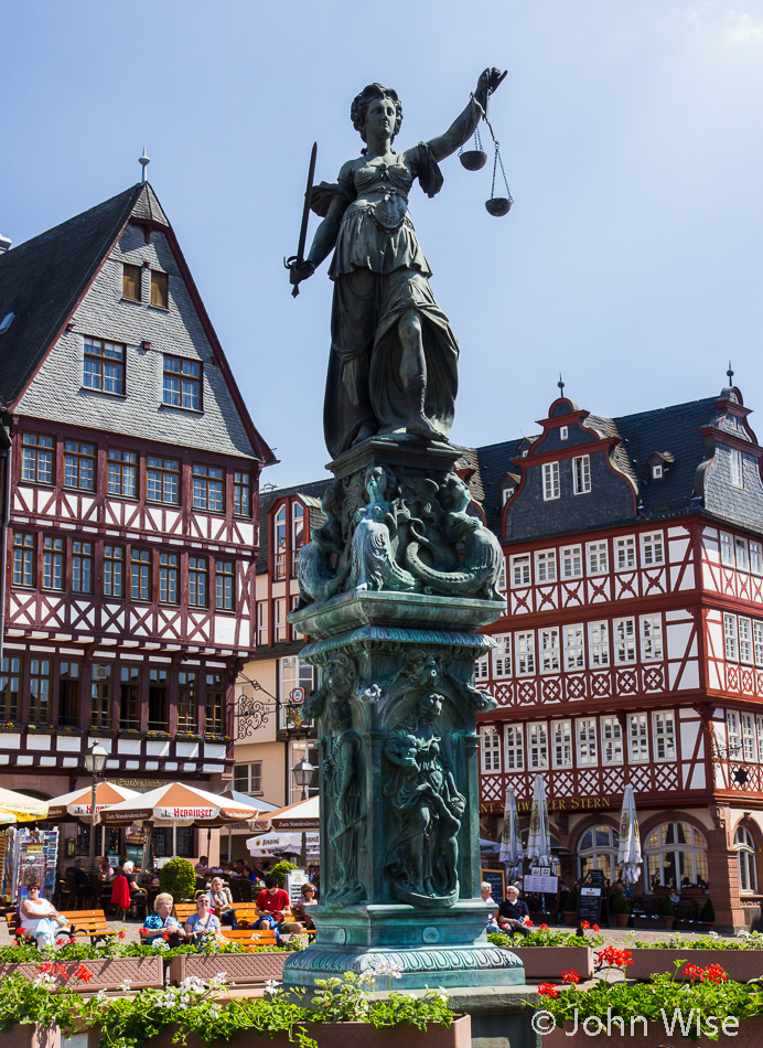 Lady Justice standing vigil at Römer in Frankfurt, Germany