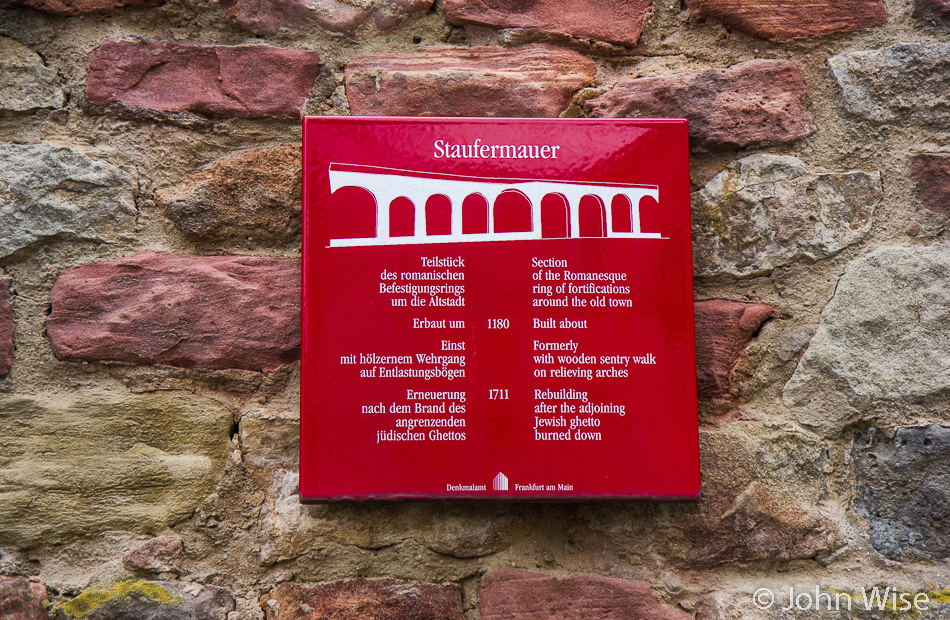 A sign pointing out a few details regarding the old city wall in Frankfurt, Germany