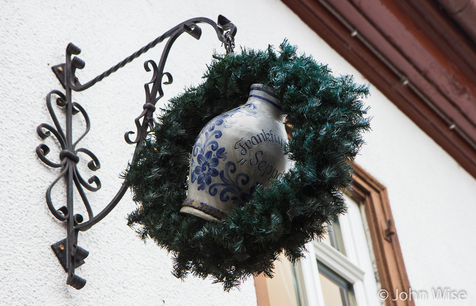 The sign outside of Frankfurter Hof Seppche with a Bembel as part of it. In Schwanheim, Germany
