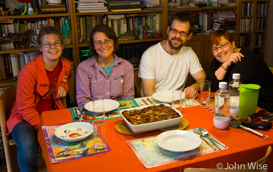 Katharina Engelhardt, Caroline Wise, Klaus and Stephanie Engelhardt enjoying dinner at home in Frankfurt, Germany