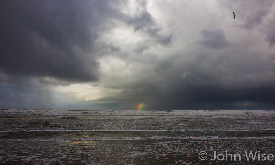 A short rainbow in the distance at South Beach State Park in Oregon