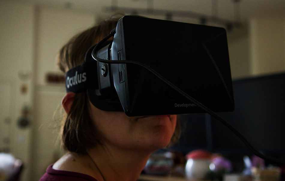 Caroline Wise wearing the Oculus Rift checking out the Grand Canyon in virtual reality