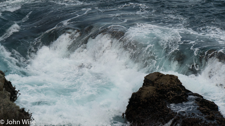 Surf spilling into a shallow basin in Point Lobos State Natural Reserve