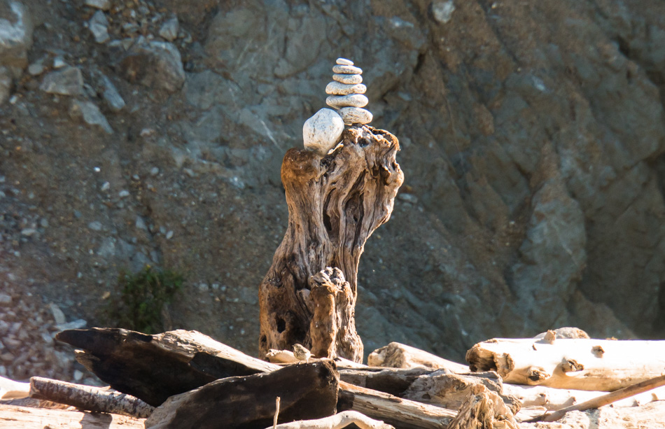 A cairn held high atop a piece of drift wood at Andrew Molera State Park