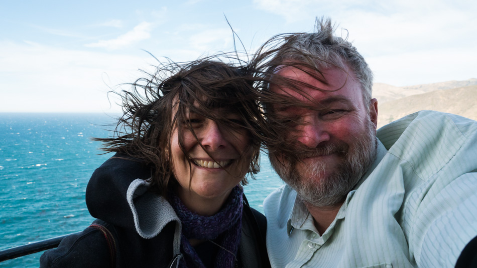 Caroline Wise and John Wise atop the Point Sur Lighthouse on a windy day
