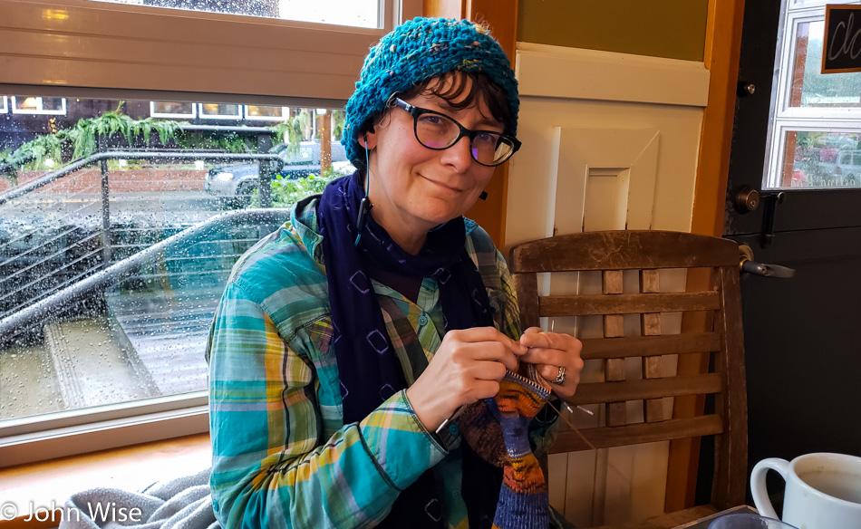 Caroline Wise knitting socks at Insomnia Coffee in Cannon Beach, Oregon